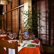 This is a photograph of a restaurant interior — ストック写真