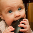 Stock Photo: Little baby playing with computer mouse