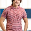 Portait of a young man standing with his hands in pocket — Stock Photo #5740798