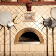 A wood-fired pizza oven - Stock Photo