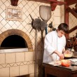 Foto Stock: Chef making a Pizza Base