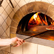 Chef making a Pizza Base - Stock Photo