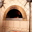 Delicious pizza from wood fired traditional oven — Stock Photo