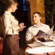 A waiter taking order — Stockfoto
