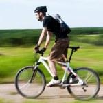 A man riding a mountain bike — Stock Photo