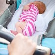 Sleeping newborn baby in the pram — Stock Photo