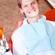 Foto Stock: Happy patient in dental chair