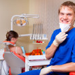 Young dentist in his office looking at the viewer — Stock Photo