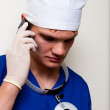 Foto Stock: Doctor phoning client with bad news