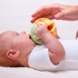 Small laying baby with toy — Stock Photo #5741348