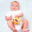 Small laying baby with toy — Stock Photo #5741353