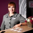 Foto Stock: Receptionist at reception desk