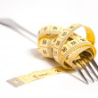 Stock Photo: Measuring tape on fork concept