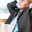 Portrait of a satisfied young businessman resting — Stock Photo