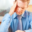 Stock Photo: Portrait of a young businessman with headache