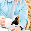 Foto Stock: Closeup of businessmworking with notebook
