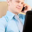 Foto Stock: Young businessmtalking on phone