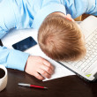 Young businessman sleeping on his table — Stock Photo #5741626