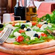 Closeup of a pizza with prosciutto - Lizenzfreies Foto