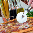 Closeup of a pizza with salami and mushrooms — Stock Photo #5741818