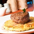 Foto Stock: Closeup of Rossini veal with fried potatoes