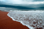 Stormy beach — Stockfoto