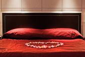 Hotel`s bed — Stock Photo
