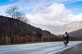 Motorcyclist on the rural road — Stok fotoğraf