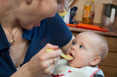 A cute little baby fed by her mother — Stock Photo