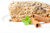 Nice cake with mint and cinnamon isolated on white — Stok fotoğraf