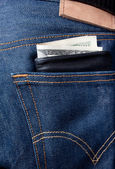 Wallet sticking out of pocket — Stock Photo