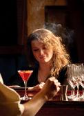 A beautiful woman at the bar — Stock Photo