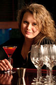 A beautiful woman at the bar — Stock Photo