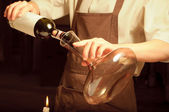 A sommelier pouring red wine — Fotografia Stock
