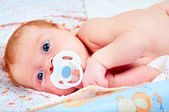 Newborn baby with soother — Stock Photo