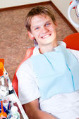 Happy patient in dental chair — Stock Photo