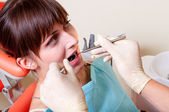 Young dentist at work — Stockfoto