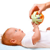 Small laying baby with toy — Stock Photo
