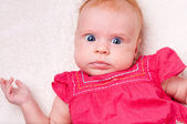 Baby girl in pink dress — Stockfoto