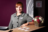 Receptionist at the reception desk — Stock Photo
