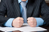 Closeup of businessman with clenched fists — Stock Photo