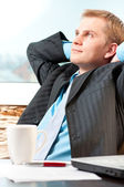 Portrait of a satisfied young businessman resting — Foto de Stock