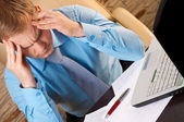 Portrait of a young businessman with headache — Stock Photo