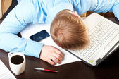 Young businessman sleeping on his table — Stock Photo