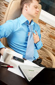 Young businessman with health problems — Stock Photo