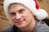 Portrait of young male with Santa Claus hat — Stock Photo