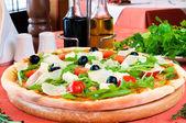 Closeup of a pizza with prosciutto — Stock Photo