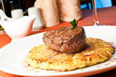 Closeup of a Rossini veal with fried potatoes — Stock Photo