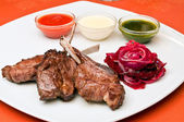 Closeup of a grilled lamb ribs with beet-root carpaccio — Zdjęcie stockowe