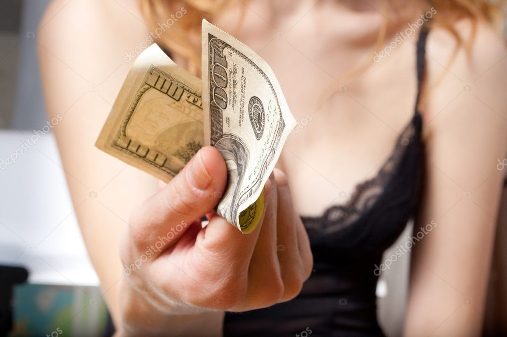 Young woman holding a dollar banknote in her hand  Stock Photo #5740920